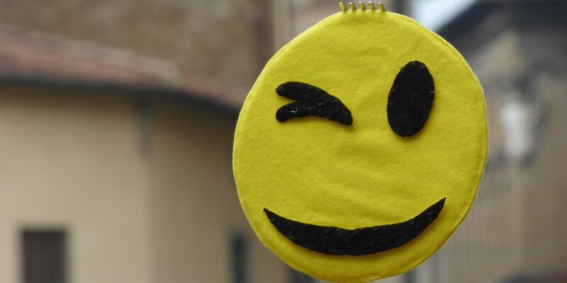 This is a photo of a winky face emoji.